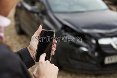 loss adjuster taking photo of damaged