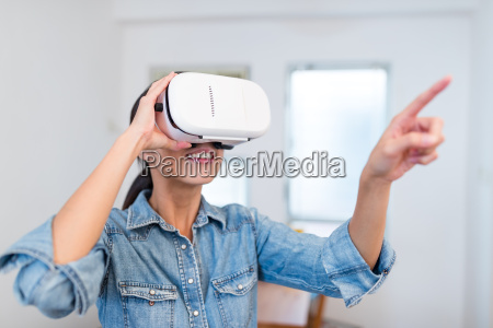 woman watching with vr device and