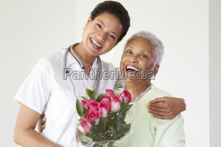 african american woman hugging nurse