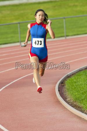 japanese runner running on racetrack