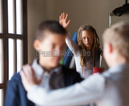 teacher trying to stop a fight