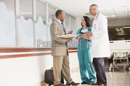 doctors and drug salesman talking in