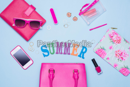 summer concept pink handbag with accessories