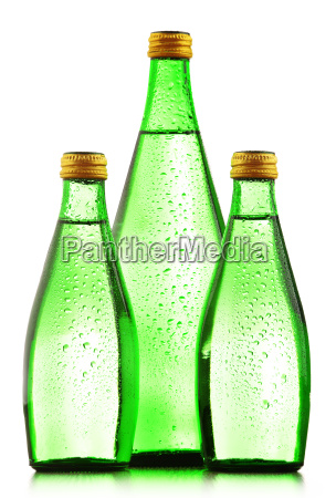 glass bottles of mineral water isolated
