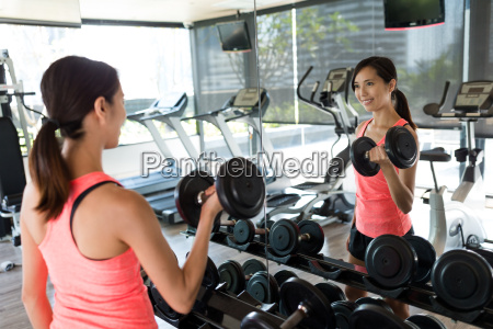 woman practices weight lifting of the