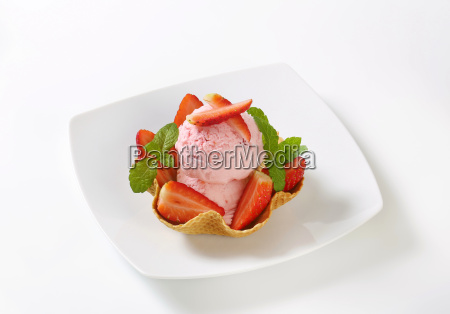 ice cream and strawberries in waffle