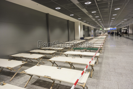 empty camp beds are standing row