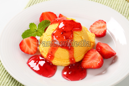 yellow ice cream with strawberries