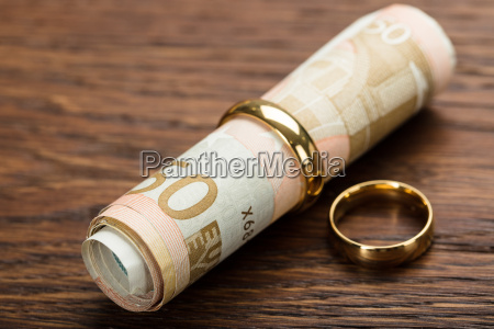 golden rings with rolled up euro