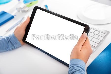 woman holding blank digital tablet