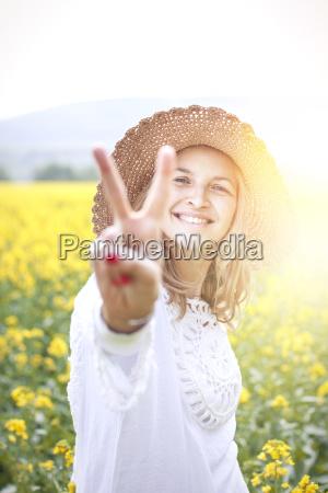 young woman in a rape field