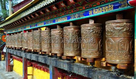 stringed golden prayer wheels