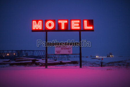 a neon motel sign lit up