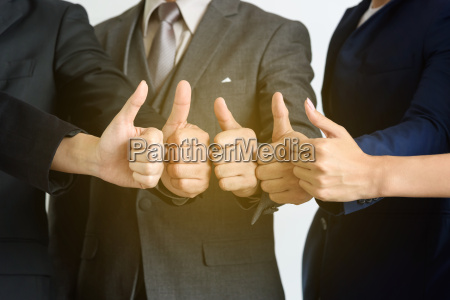 business teamwork show hands with thumb