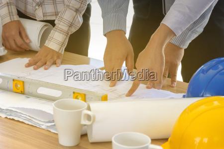 business teamwork working on blueprint