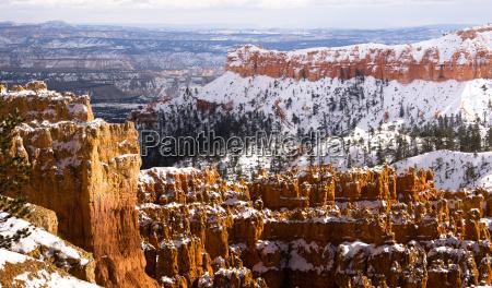fresh snow blankets bryce canyon rock