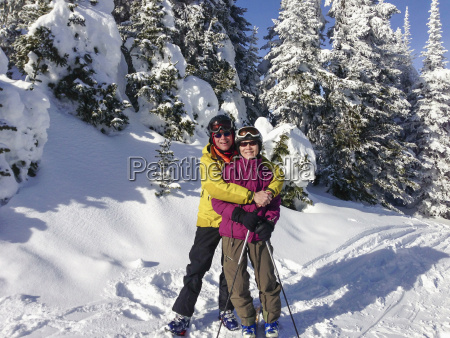 father and daughter wearing ski gear