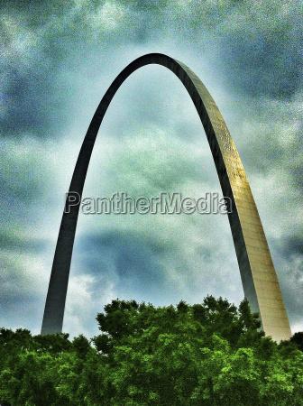 gateway arch against cloudy sky st