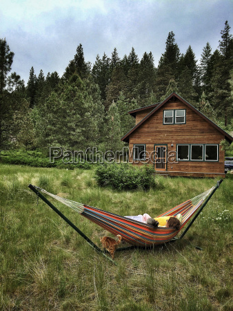 children relaxing in hammock in rural