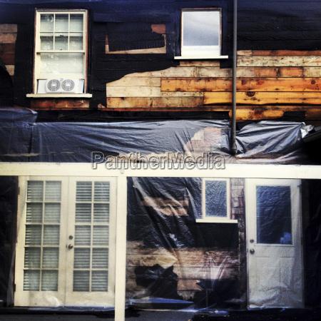 plastic wrap siding of house under