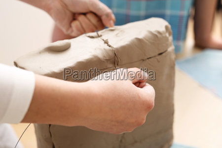 clipping the clay block with a