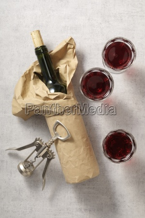 a packed wine bottle glasses of