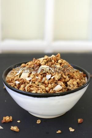 crunchy muesli in a ceramic bowl