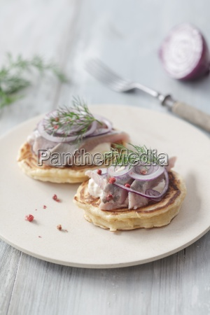 pancakes with herring onions and dill