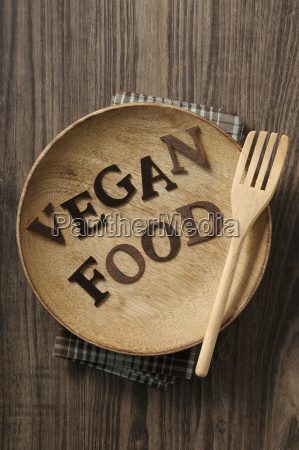 vegan food written on a wooden