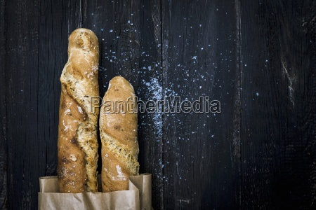 homemade malt baguettes in a paper