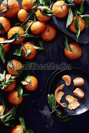 tangerines with leaves whole and peeled