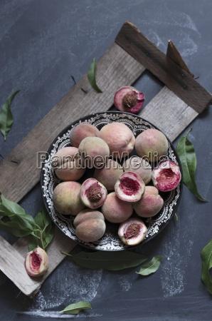 fresh peaches on a plate