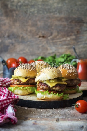homemade burgers with pickled cucumbers