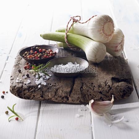 fresh bulbs of garlic with salt