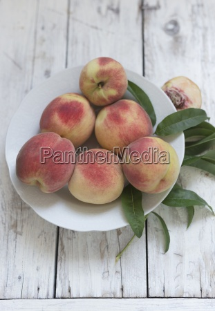 fresh peaches with leaves on a