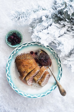 duck breast with cranberry sauce on