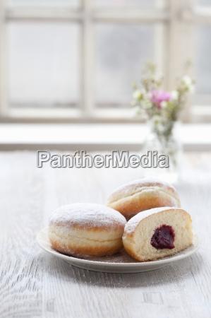 jam doughnuts on a plate next