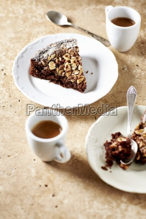 slices of chocolate cake with hazelnuts