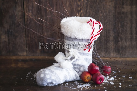 a, christmas, boot, with, apples, and - 21857407