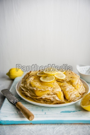 a stack of panakes with lemon