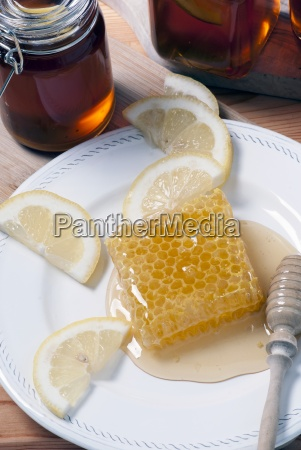 honey comb on plate with lemons