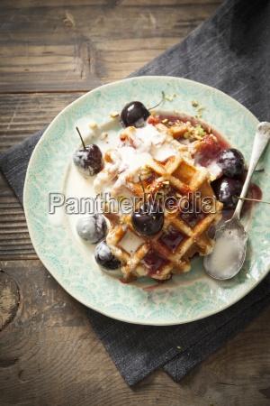round belgian waffles with cream cherries