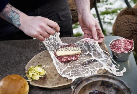 preparing burgers for camping wrap meat