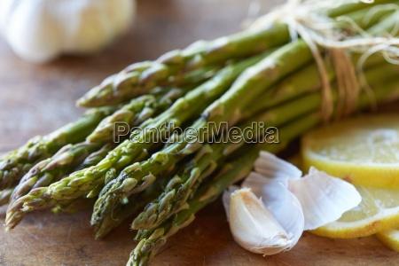 green asparagus garlic and lemons
