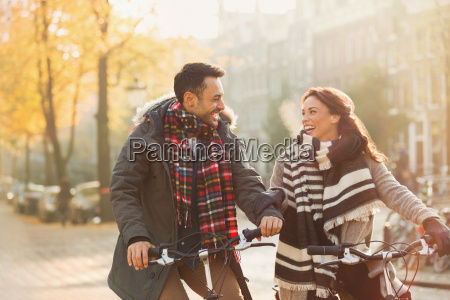 smiling young couple in warm clothing