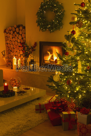 ambient fireplace and candles illuminating living