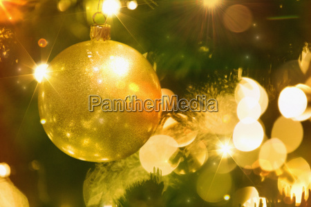close up golden ornament and string