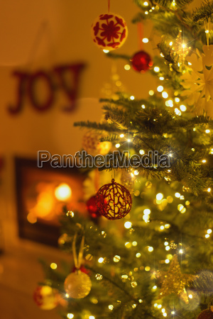 ornaments hanging from christmas tree with