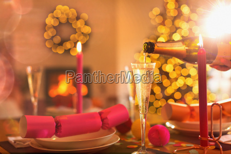 pouring champagne into champagne flute on