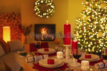 ambient candles and christmas crackers on